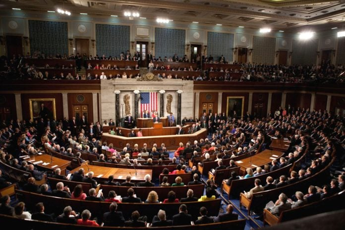 United States congress room, with the American flag in the center.