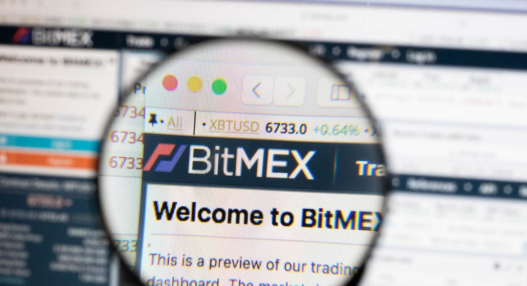 BitMEX logo on a computer screen with a magnifying glass.