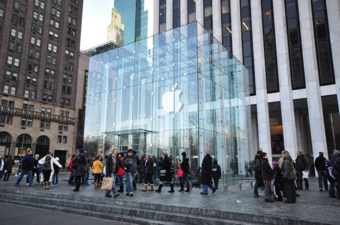 Apple Building with a huge glass box in front of it.