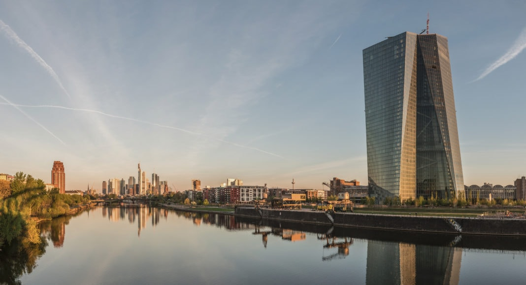 Seat of the European Central Bank and Frankfurt Skyline at dawn.
