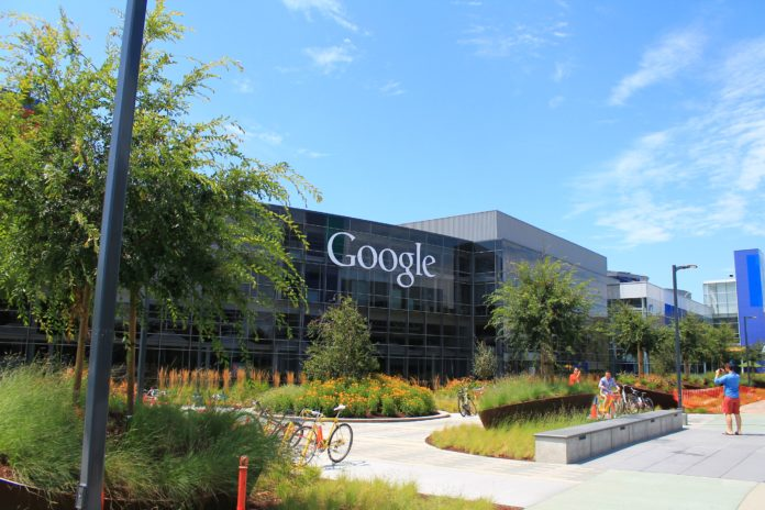 Google Headquarters (also called Googleplex) with greenery in front of it.