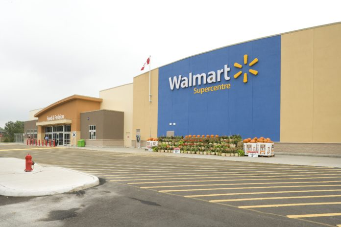 Walmart logo on the side of the supercentre.