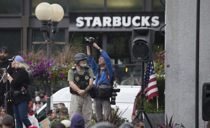 Photographer and a soldier in front of a Starbucks.